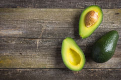 Food background with fresh organic avocado on  old wooden table Royalty Free Stock Photography