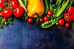 Food background with fresh organic vegetables. top view. Food background - raw organic vegetables, fresh ingredients for healthily cooking on black background Stock Photos