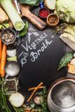 Food background for Healthy Vegetable broth cooking recipes with organic ingredients. Top view with handwritten text royalty free stock photos