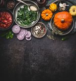 Food background for healthy vegetarian cooking ingredients for tasty pumpkin dishes recipes in bowls : tomato sauces, spinach, sli Stock Images