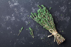 Food background of herb thyme on black kitchen table from above. Food background of herb thyme on black kitchen table royalty free stock photography