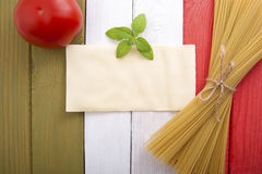 Food on the background of the Italian flag. Royalty Free Stock Photos