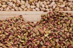 Food Background. A lot of pistachios. Useful and tasty nut. A lot of pistachios are on the table in the store. Useful and tasty nut Royalty Free Stock Photography
