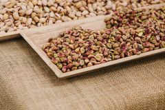 Food Background. A lot of pistachios. Useful and tasty nut. A lot of pistachios are on the table in the store. Useful and tasty nut Stock Photos