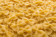 Food background made of raw Farfalle noodles. From top view Stock Photo