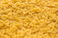 Food background made of raw Farfalle noodles. From top view Stock Image