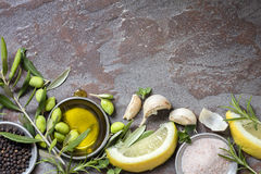 Food Background with Olives, Oil, Lemon, Garlic, Herbs and Spice Royalty Free Stock Photos