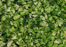 Food background pattern - fresh raw sliced broccoli, prepared for cooking - bio healthy green food concept. A heap of broccoli sliced and cut into small pieces Royalty Free Stock Photography