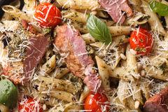 Food background: Penne pasta with meat and pesto closeup. Top vi Stock Photography