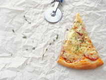 Food background.  Piece of freshly made pepperoni pizza upon baking parchment. Homemade pizza with thyme. Copy space for your text Stock Images