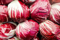 Food background Red cabbage heads. Shinny red cabbage forming an interesting and colorful background at the farmers market, cabbage can be one of the five-a-day Royalty Free Stock Image
