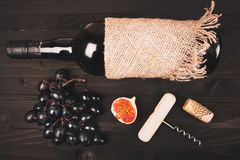 Food background with red wine, figs, grapes and cheese Stock Photo