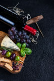 Food background,rustic board with cheese herbs and wine Stock Images