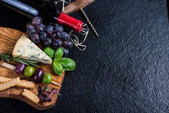 Food background,rustic board with cheese herbs and wine Stock Photography