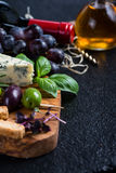 Food background,rustic board with cheese herbs and wine Stock Image