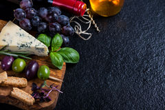 Food background,rustic board with cheese herbs and wine Stock Photos