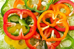 Food background - sliced colorful peppers Royalty Free Stock Photos