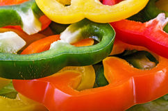 Food background - sliced colorful peppers Stock Image