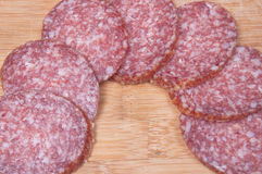 Food background of sliced salami Stock Images