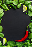 Food background with spinach and red chili pepper Stock Photography