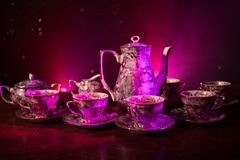 Free Food Background Tea And Coffee Theme. Old Vintage Ceramic Tea Or Coffee Pot With Cups Jug And Sugar Cup On Dark Background With Li Stock Photography - 125142962