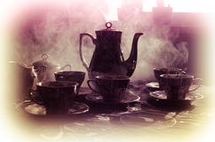 Food background tea and coffee theme. Old vintage ceramic tea or coffee pot with cups jug and sugar cup on dark background with li Royalty Free Stock Photo
