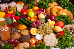 Food background. Vegetables, fruits, greens and bread food background. shallow DOF Royalty Free Stock Photography