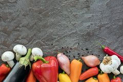 Food Background Vegetables on Slate Top view. Food background with fresh vegetables on slate, top view with copy space stock images