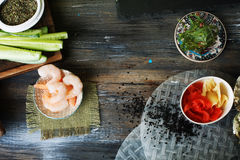 Food background, a wooden table, top, sushi, rolls, cucumbers, Chuka, shrimp, salmon, Stock Photos