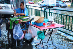 FOOD IN BANGKOK, THAILAND - NOVEMBER 04. BANGKOK, THAILAND - NOVEMBER 04 : Heavy flooding from monsoon rain in Ayutthaya and north Thailand arriving in Bangkok Royalty Free Stock Image