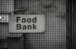 Food Bank Sign. A Grungy Sign For A Food Bank In A Backstreet Royalty Free Stock Photos