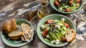 Food banner. Italian vegetable salad with avocado, cherry tomatoes, arugula and mozzarella cheese. Delicious and healthy food. Food banner.  Delicious and royalty free stock photos