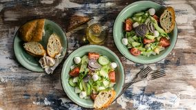 Food banner. Vegetable salad. Delicious salad with avocado, cherry tomatoes, arugula and mozzarella cheese. Tasty and healthy food. Food banner.  Tasty and royalty free stock photos