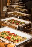 Food banquet table with chafing dish heaters Stock Photo