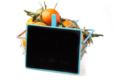 Food basket of tangerines with chalkboard Stock Photography