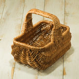 Food basket on wooden table. Image of food basket on wooden table Royalty Free Stock Photos