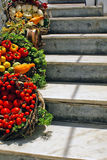 Food Baskets on steps in Santorini island Stock Photo