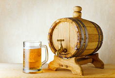 Beer and barrel on wood table Royalty Free Stock Image