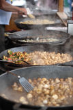 Food being prepared in large pans Royalty Free Stock Photos