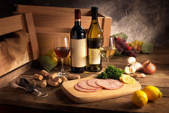 Food and beverage. Display of wine and some food Royalty Free Stock Photography