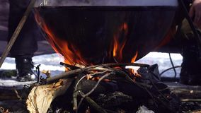 Food in a big kettle cooked on fire. Food in a big kettle cooked on a fire stock video footage