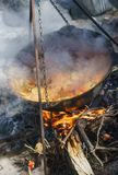 Food in a big kettle cooked on fire. Food in big kettle cooked on fire Royalty Free Stock Image