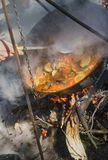 Food in a big kettle cooked on fire. Food in big kettle cooked on fire Stock Image