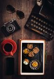 Food blog concept. With sweet cookies on tablet pc on wooden desk Royalty Free Stock Photo
