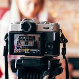 Food blogger camera equipment woman vlog kitchen royalty free stock image