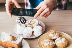 Food blogger dessert man smartphone fresh pastries royalty free stock photos