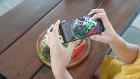 Food blogger hands using smartphone taking photo of beautiful beef steak on wood table. Food blogger hands using smartphone taking photo of beautiful beef steak stock footage