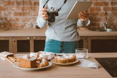 Food blogger hobby lifestyle tablet cakes pastries stock image
