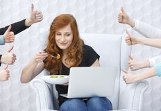 Food blogger with laptop. Around hands holding thumbs up stock photography