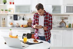 Food blogger taking photo of breakfast. In kitchen royalty free stock photography
